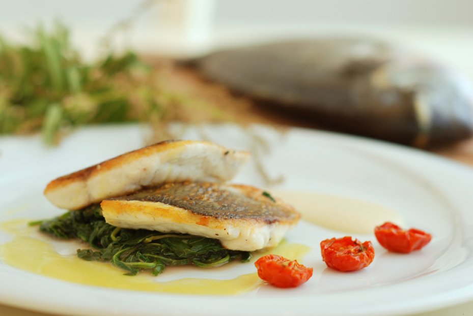 Bass fish with swiss chard, celeriac puree and agriomaratho sauce