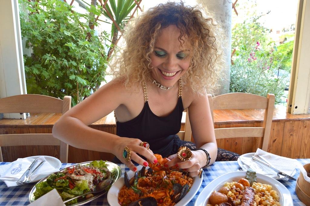 Christina Zygouri enjoys seafood at ''Giannis#2'' fish restaurant.